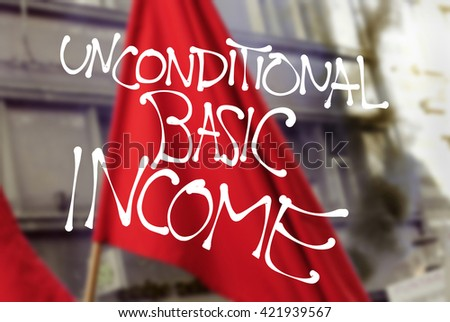 New Left - revolutionary text Unconditional Basic Income over blurred photo of red flag. Appeal to establish progressive social security system - universal welfare benefit - stock photo