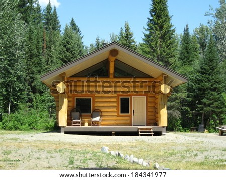 New log cabin in the wilderness - stock photo