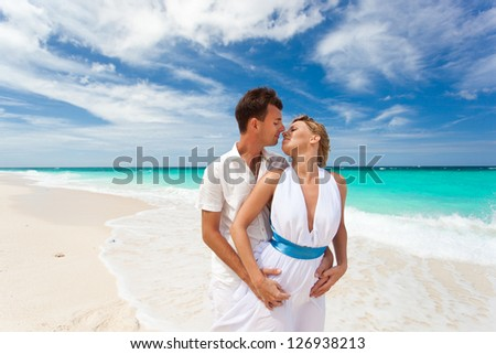 New married couple on white beach - stock photo