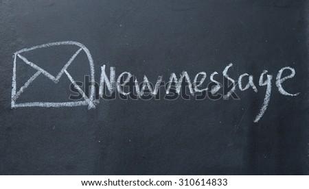 new message sign on blackboard - stock photo