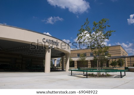 New Middle School in Florida with Blue Sky and Landscaping. - stock photo