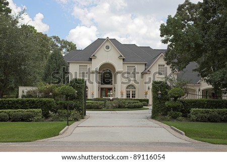 New million dollar homes in affluent neighborhood, sales are steady - stock photo