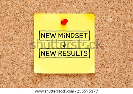 New Mindset New Results written on a yellow sticky note pinned on a bulletin board. - stock photo