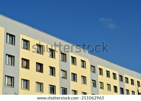 New modern apartments town building on blue sky - stock photo