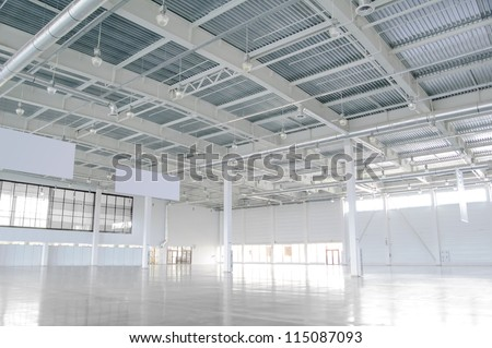 New Modern Empty Storehouse. Huge Light Empty Storehouse - stock photo