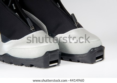 New modern gray cross country ski boots - stock photo