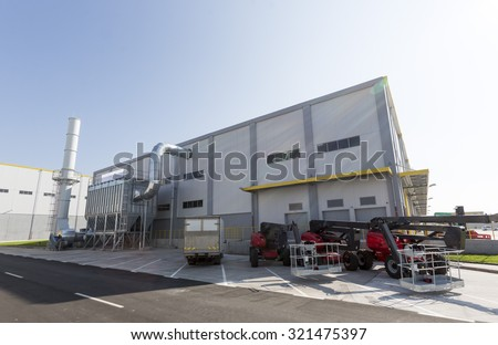 New modern industrial waste plant from the outside. Waste-to-energy plant. Produces a combustible fuel commodity, such as methane, methanol, ethanol and synthetic fuels. - stock photo