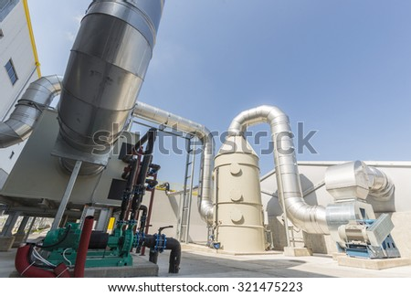 New modern industrial waste plant pipelines from the outside. Waste-to-energy plant.  Produces a combustible fuel commodity, such as methane, methanol, ethanol and synthetic fuels. - stock photo