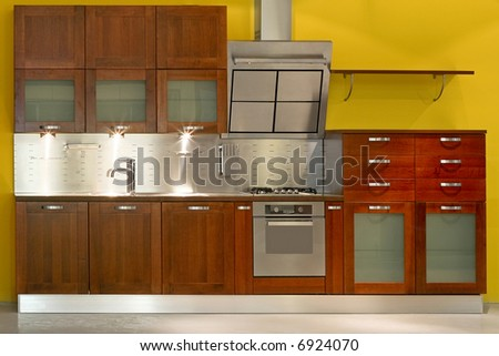 New modern kitchen with metal and wood - stock photo