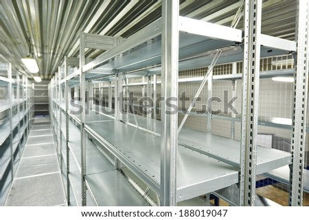 New modern metal warehouse shelves construction - stock photo