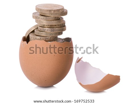 new money growing from a new hatched egg isolated on a white background - stock photo