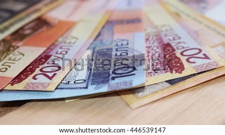 new money is on wooden background - stock photo