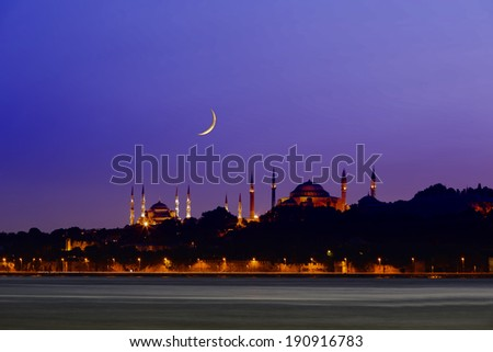 New moon over historical Eminonu peninsula at twilight, Istanbul - Turkey On the left side, you can see Blue Mosque (Sultanahmet) and on the right side, you can see Hagia Sophia. - stock photo