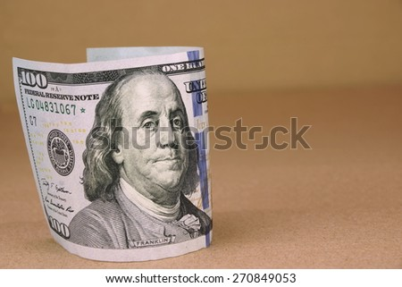 New One Hundred USA Dollar Bill On The Rough Paper Background - stock photo