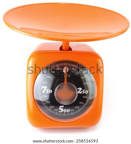 new orange  kitchen scale isolated on white - stock photo