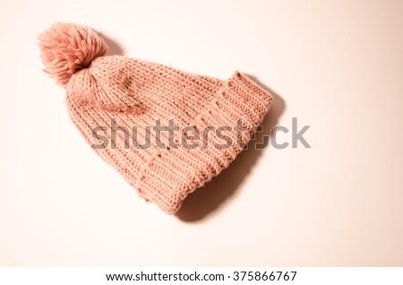 New Orange Knit Wool Hat with Pom Pom isolated on white background - stock photo