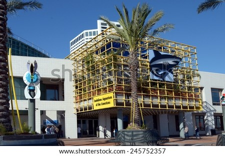 NEW ORLEANS, JANUARY 17: The Audubon Aquarium Of The Americas attracts Mardi Gras visitors and locals alike in New Orleans, Louisiana on January 17, 2015.  The aquarium opened in 1990.   - stock photo