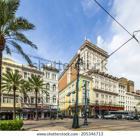 NEW ORLEANS - JULY 16, 2013: crossing canal street with bourbon street and famous Astor hotel in New Orleans, USA. The Astor boasts of 693 hotel rooms and over 32,000 square feet of meeting rooms. - stock photo