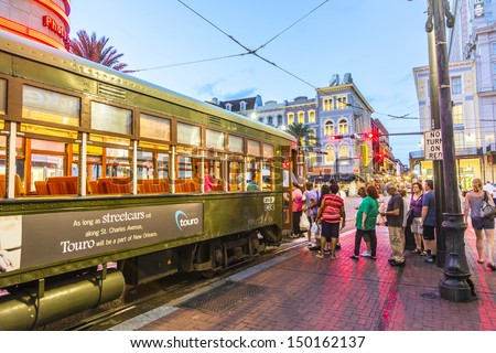 NEW ORLEANS - JULY 14: people travel with the famous old Street car St. Charles line on July 14, 2013 in New Orleans, USA.  It is the oldest continually operating street car line in the world. - stock photo