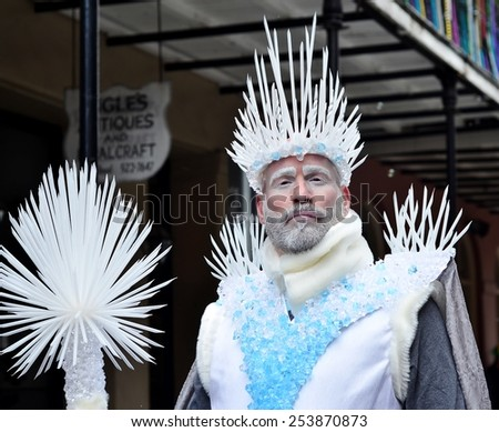 NEW ORLEANS, LA.-FEBRUARY 17:  Masqueraders parade through the streets of the New Orleans French Quarter on Mardi Gras Day, Tuesday, February 17, 2015. - stock photo