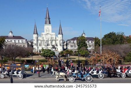 NEW ORLEANS, LA-JAN 17:  Tourists in town for Mardi Gras enjoy a sunny day in Jackson Square in New Orleans, La. on January 17, 2015. - stock photo
