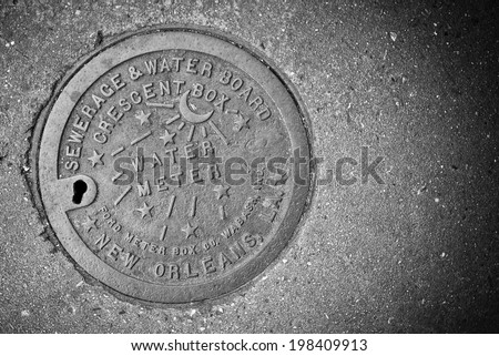 NEW ORLEANS, LA - JANUARY 5, 2012: New Orleans Water meter cover. - stock photo