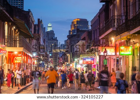 NEW ORLEANS, LOUISIANA - AUGUST 23: Pubs and bars with neon lights  in the French Quarter, downtown New Orleans on August 23, 2015.  - stock photo