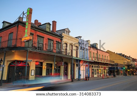 NEW ORLEANS, LOUISIANA - AUGUST 25: Pubs and bars with neon lights  in the French Quarter, New Orleans on August 25, 2015.  - stock photo