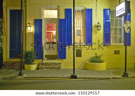 NEW ORLEANS, LOUISIANA - CIRCA 2004: Hotel at night in French Quarter near Bourbon Street in New Orleans, Louisiana - stock photo