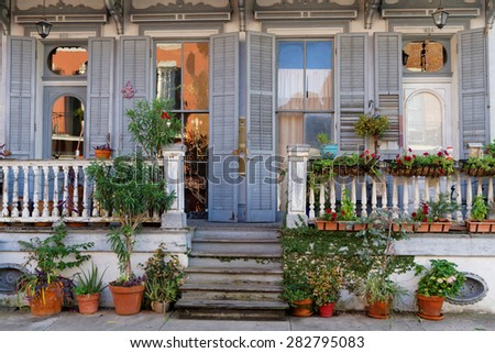 NEW ORLEANS, LOUISIANA, May 5, 2015 : Wood house in the French Quarter. French Quarter, also known as the Vieux Carre, is the oldest neighborhood in the city of New Orleans. - stock photo