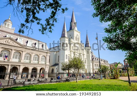 NEW ORLEANS, LOUISIANA USA - MAY 1, 2014:  The beautiful Saint Louis Cathedral and museums seen from Jackson Square in the French Quarter in New Orleans, Louisiana. - stock photo