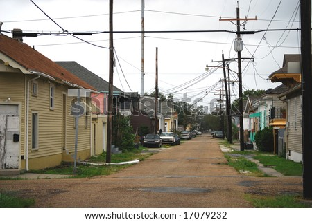 NEW ORLEANS - SEPT 1: An empty street with power lines at corner of Harmony and Chippewa is shown during Hurricane Gustav on September 1, 2008 in southern New Orleans. - stock photo