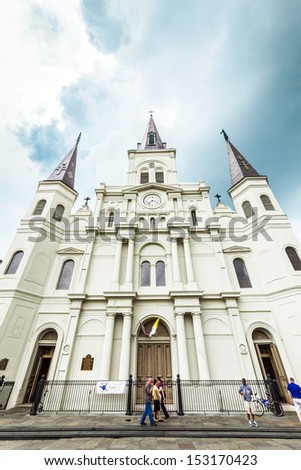 NEW ORLEANS, USA - JULY 15: famous St. Louis Cathedral at Jackson Square, in the  French Quarter on July 15, 2013 in New Orleans, USA. Three Roman Catholic churches have stood on the site since 1718. - stock photo