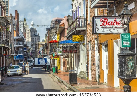 NEW ORLEANS, USA - JULY 17: historic building in the French Quarter on July 17, 2013 in New Orleans, USA. Tourism provides a large source of revenue after the 2005 devastation of Hurricane Katrina. - stock photo