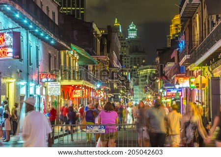 NEW ORLEANS, USA - JULY 14, 2013: Neon lights in the French Quarter in New Orleans, USA. Tourism provides a much needed source of revenue after the 2005 devastation of Hurricane Katrina. - stock photo