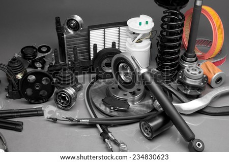 New parts for motor vehicles on a gray background closeup. Large depth of field - stock photo