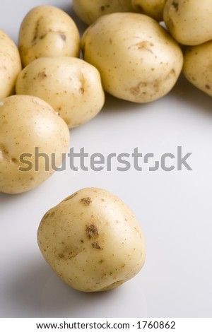 New potatoes against a white  background - stock photo
