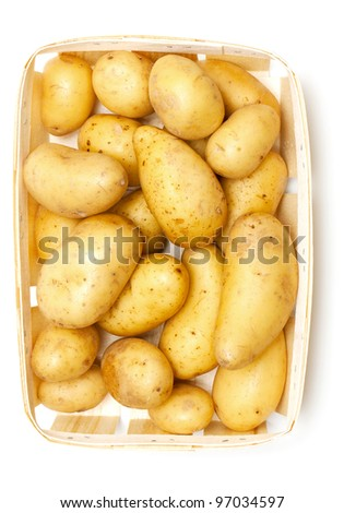new potatoes in basket isolated on white background - stock photo