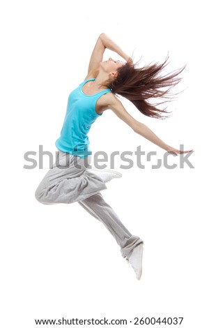 New pretty modern slim hip-hop style dancer teenage girl jumping dancing isolated on a white studio background - stock photo