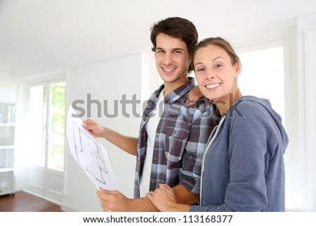 New property owners looking at home blueprint - stock photo
