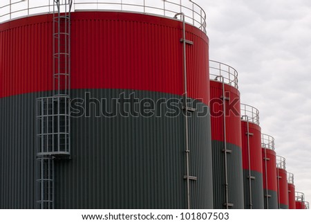 new red and gray oil storage tanks - stock photo