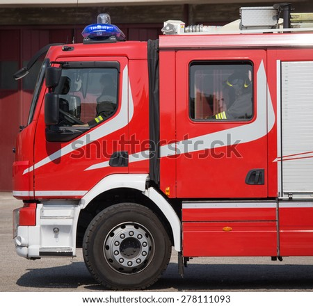 new red fire trucks with sirens blue ready for emergency - stock photo