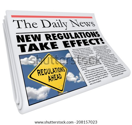 New Regulations Take Effect newspaper headline informing you of rules and laws impacting your life, business or career - stock photo