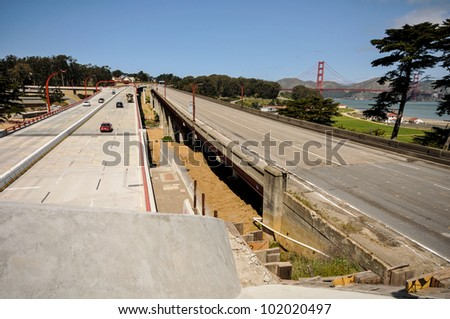 New roadway next to old abandoned roadway. - stock photo