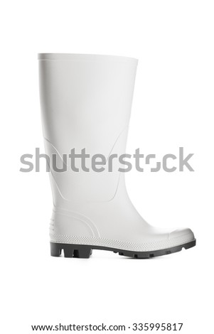 New rubber boot isolated on white background - stock photo