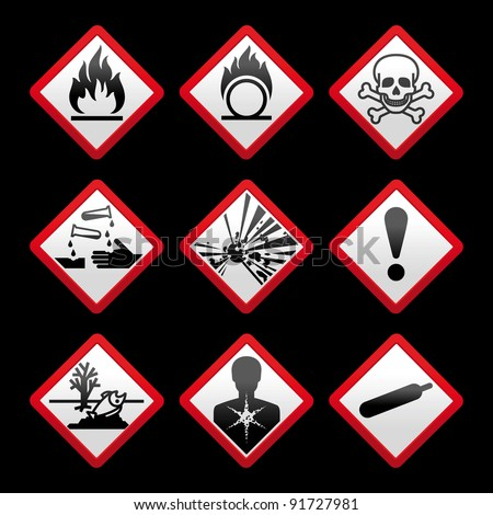 New safety symbols Hazard signs Black background - stock photo