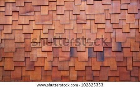 New section of a red shake cedar or redwood roof - stock photo