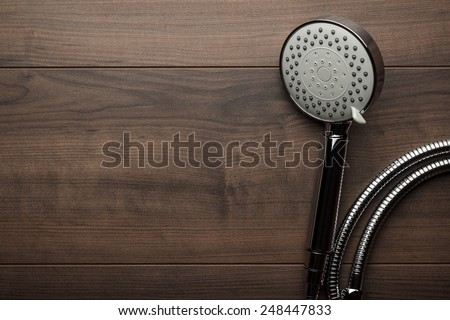 new shower head on the wooden table - stock photo