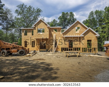 new single family home under construction - stock photo