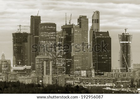 New skyscrapers business center in Moscow at night, Russia (stylised retro) - stock photo